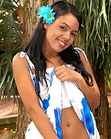 Gigi Spice looks innocent in her hawaiian dress and daisies