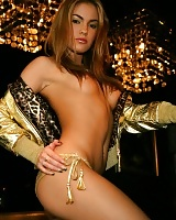 Sexy honey surrounded by and draped in gold
